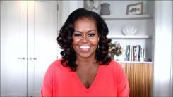 Former First Lady Michelle Obama talks with Rachael Ray
