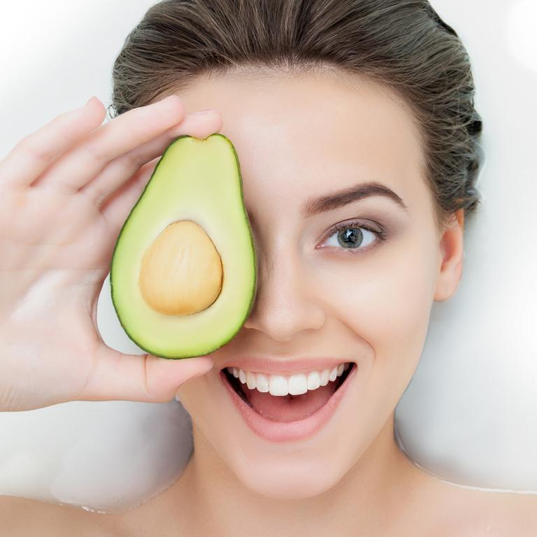 Woman holding an avocado