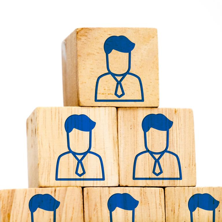 corporate profile icons on wood cubes