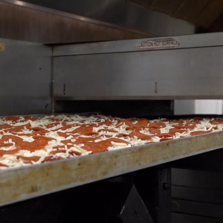 World's Largest Pizza going into the oven