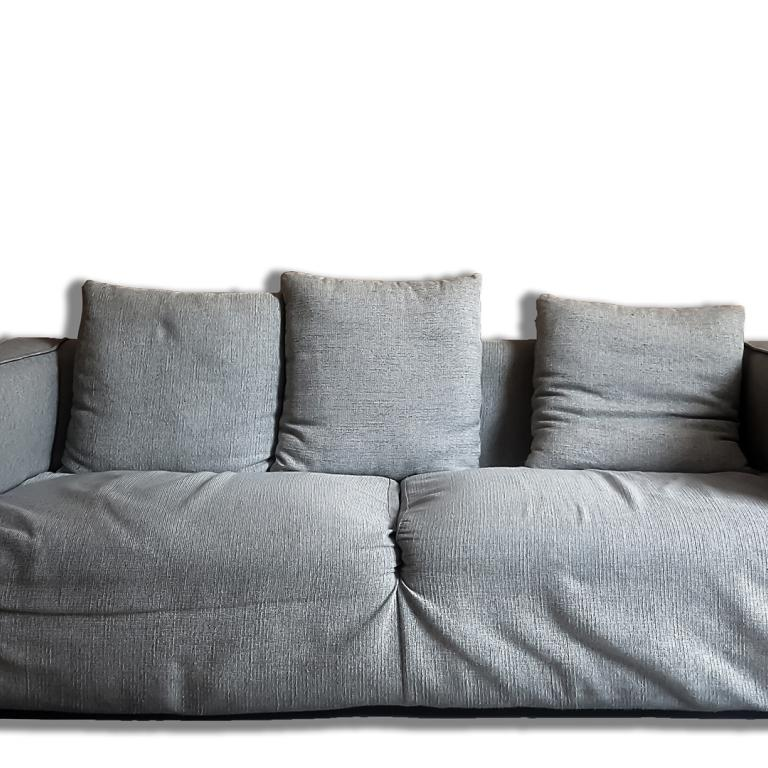 old couch with sagging cushions
