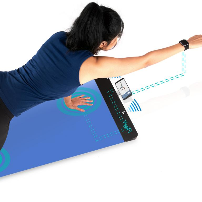 woman using YogiFi yoga mat