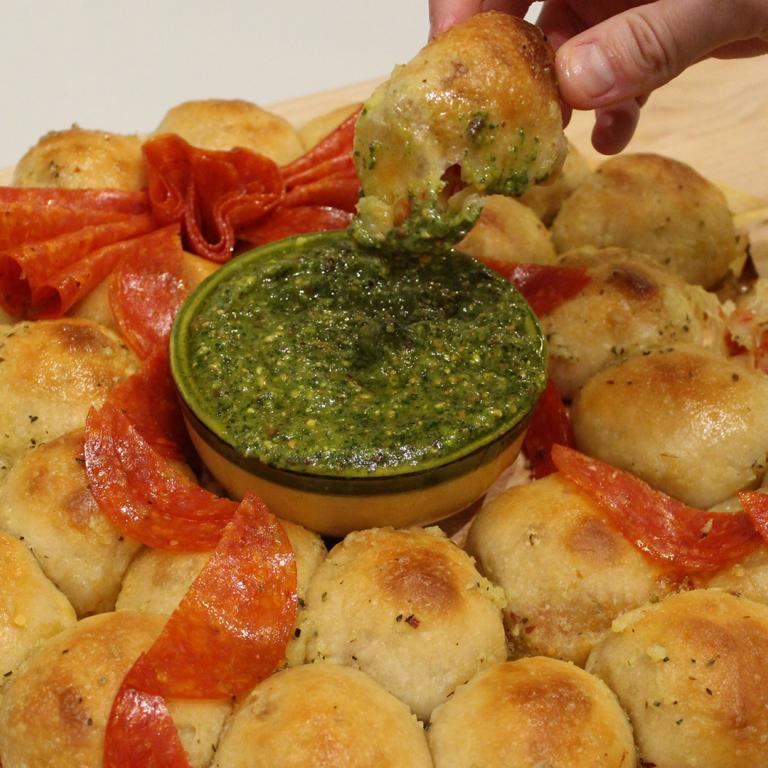 Pepperoni Pizza-Stuffed Pull-Apart Wreath With Pesto Dipping Sauce