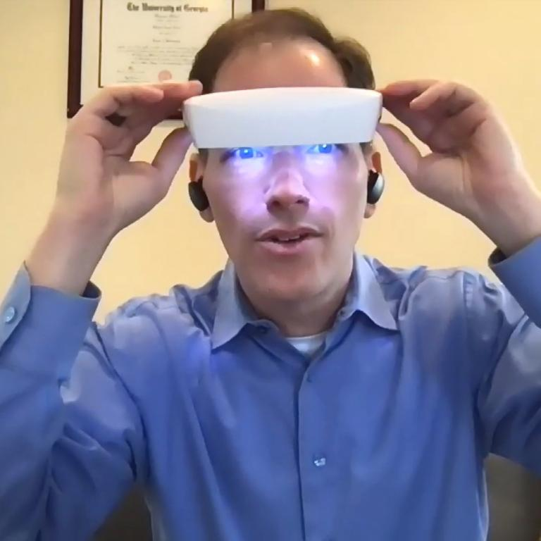 Dr. Breus wearing light therapy glasses